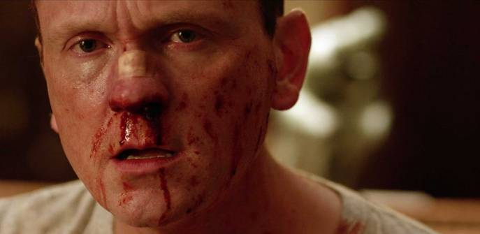 Pat Healy in Cheap Thrills bloody